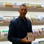 Nico de Corato showing his book Dialetto Emiratino